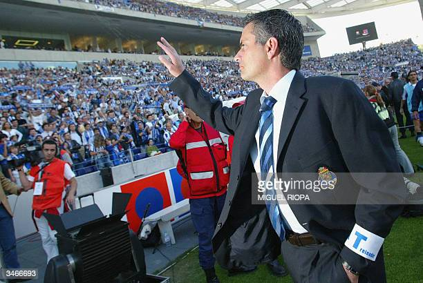 Porto's coach Jose Mourinho salutes to the supporters before the match against Alverca, during the Portuguese First League football match at Dragon...