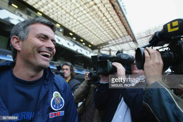 Porto's coach Jose Mourinho smiles at journalists before the training session at Riazor Stadium in Coruna a day prior to their European Champions...
