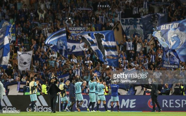 Porto's coach Sergio Conceicao and his players celebrate after winning the UEFA Champions League Group G football match AS Monaco FC vs FC Porto on...