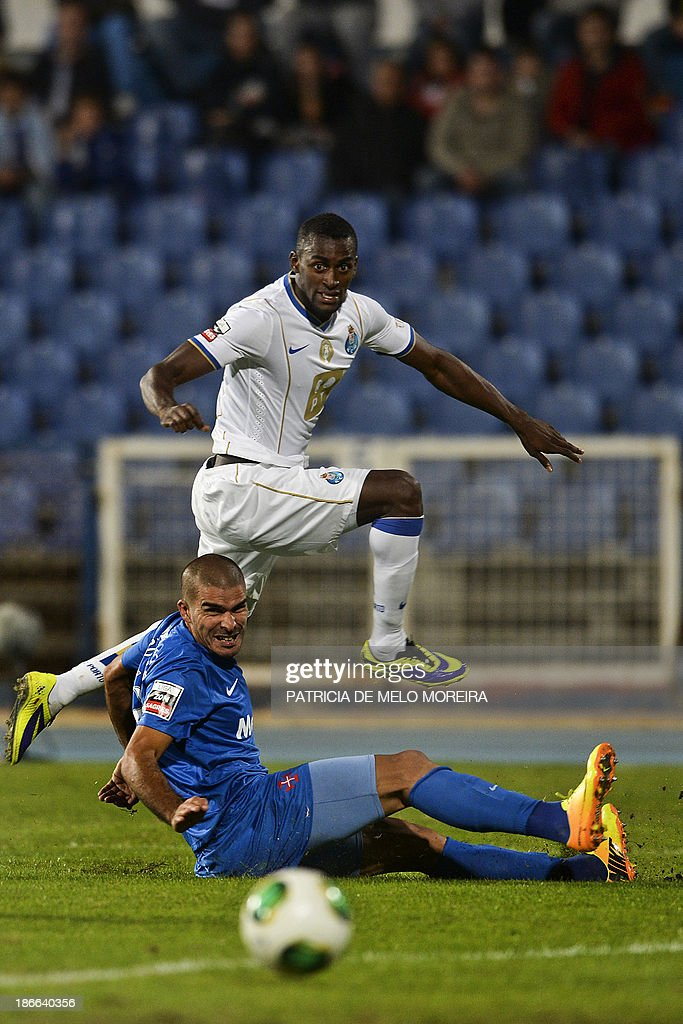 FC Porto's Colombian forward Jackson Martinez (Up) vies with Belenenses' defender Joao Afonso during the Portuguese league football match Belenses vs FC Porto at Restelo stadium in Lisbon on November 2, 2013.