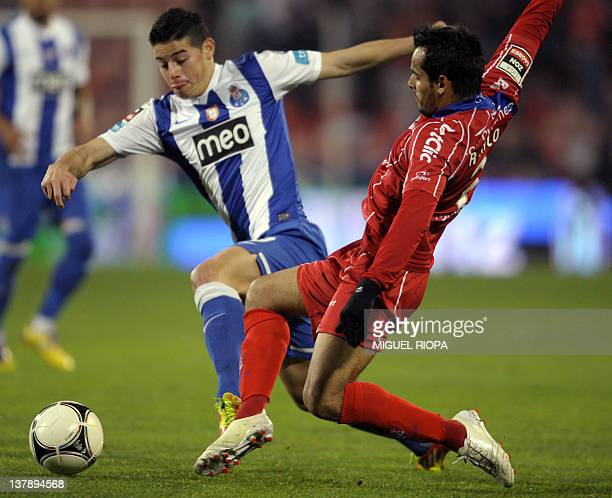 FC Porto's Colombian forward James Rodriguez vies with Gil Vicente's Brazilian defender Rodrigo Galo during their Portuguese super league football...