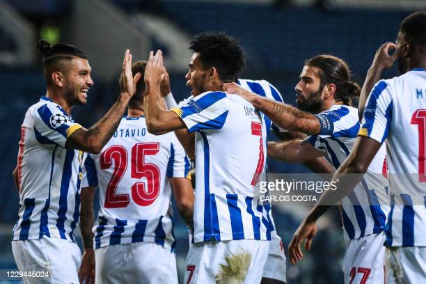 Porto's Colombian forward Luis Diaz celebrates after scoring a goal during the UEFA Champions League group C football match between FC Porto and...