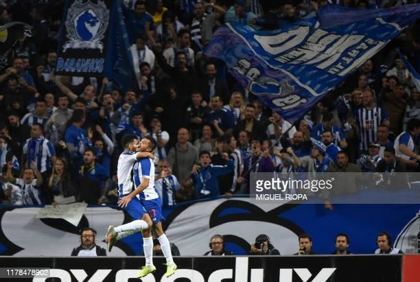 Porto's Colombian forward Luis Diaz celebrates his goal with teammate Mexican forward Jesus Corona 'Tecatito' during the Portuguese league football...