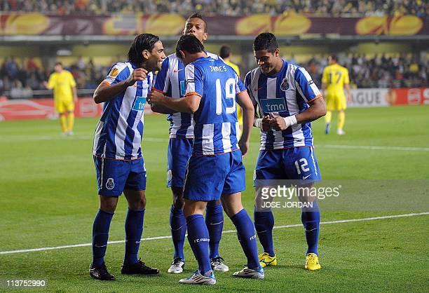 FC Porto's Colombian forward Radamel Falcao celebrates after scoring with FC Porto's Colombian midfielder Fredy Guarin FC Porto's Colombian forward...