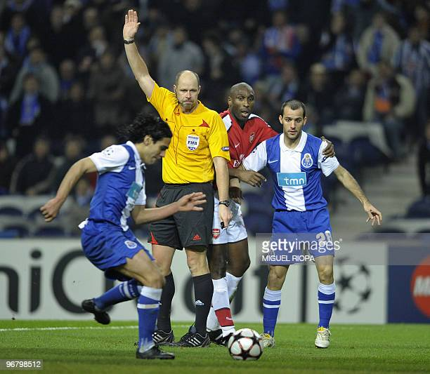 FC Porto's Colombian forward Radamel Falcao controls the ball to score his team's second goal against Arsenal under the look of referee Martin...