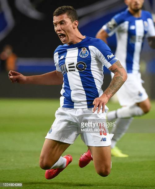 Porto's Colombian midfielder Mateus Uribe falls during the Portuguese League football match between FC Porto and Os Belenenses at the Dragao stadium...