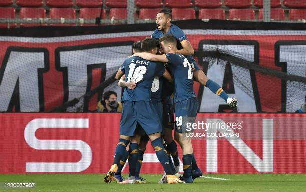 Porto's Colombian midfielder Mateus Uribe is congratulated by team mates after scoring a goal during the UEFA Champions League Group C football match...