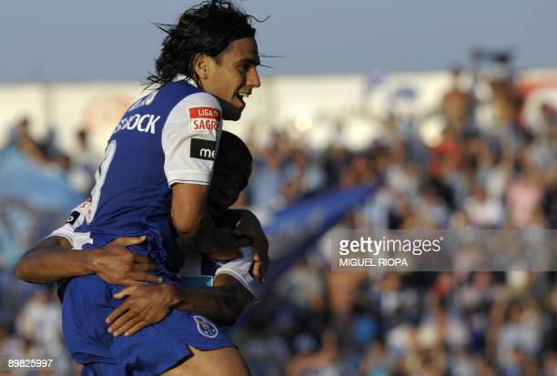 FC Porto's Colombian Radamel Falcao celebrates with a teammate after scoring against Pacos Ferreira during their Portuguese First league football...