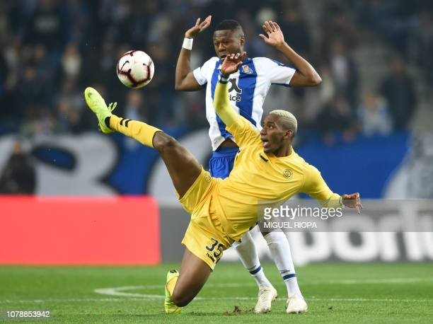 Porto's Congolese defender Chancel Mbemba vies with Nacional's Honduran forward Bryan Rochez during the Portuguese League football match between FC...