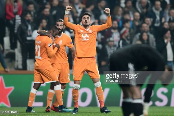 Porto's defender Alex Telles celebrates with teammates after his team scored a goal during the UEFA Champions League Group G football match between...