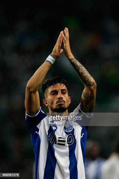 Porto's defender Alex Telles salutes the fans at the end of the Primeira Liga 2017/18 match between Sporting CP vs FC Porto in Lisbon on October 01...