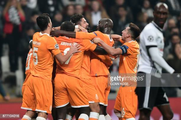Porto's defender Felipe celebrates with teammates after scoring a goal during the UEFA Champions League Group G football match between Besiktas JK...