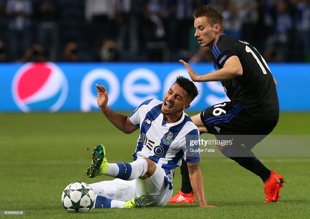 FC Porto's defender from Brazil Alex Telles tackled by FC Copenhagen's midfielder Jan Gregus during the UEFA Champions League match between FC Porto and FC Copenhagen at Estadio do Dragao on September 14, 2016 in Porto, Portugal.
