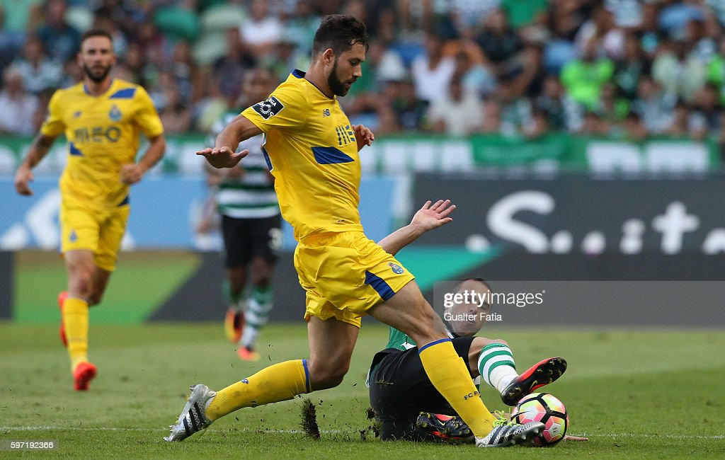 FC Porto's defender from Brazil Felipe tackled by Sporting CP's midfielder Bruno Cesar from Brazil in action during the Primeira Liga match between Sporting CP and FC Porto at Estadio Jose Alvalade on August 28, 2016 in Lisbon, Portugal.