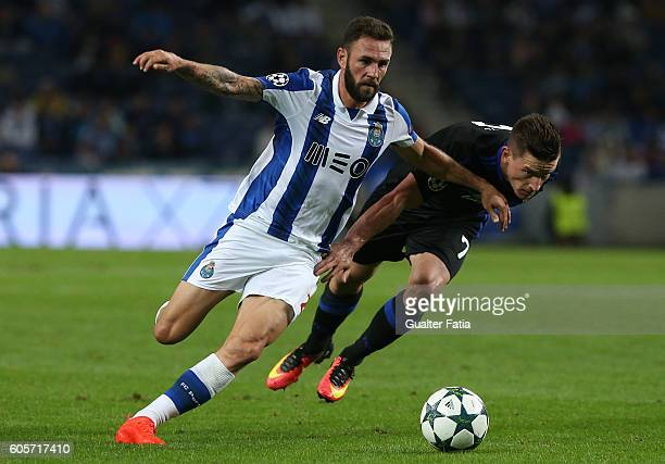 Porto's defender from Mexico Miguel Layun with FC Copenhagen's midfielder Benjamin Verbic in action during the UEFA Champions League match between FC...