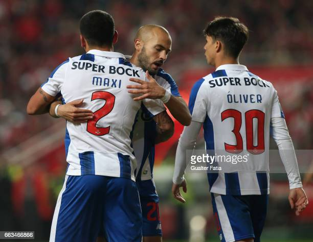 Porto's defender from Uruguay Maxi Pereira celebrates with teammate FC Porto's midfielder from Portugal Andre Andre after scoring a goal during the...