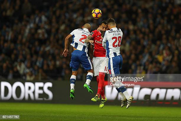 PortoÕs defender Maxi Pereira from Uruguay Benfica's forward Kostas Mitroglou from Greece and FC PortoÕs defender Felipe from Brazil in the air vies...