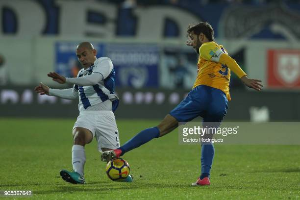 Porto's defender Maxi Pereira from Uruguay vies with GD Estoril Praia defender Joel Ferreira from Portugal for the ball possession during the match...