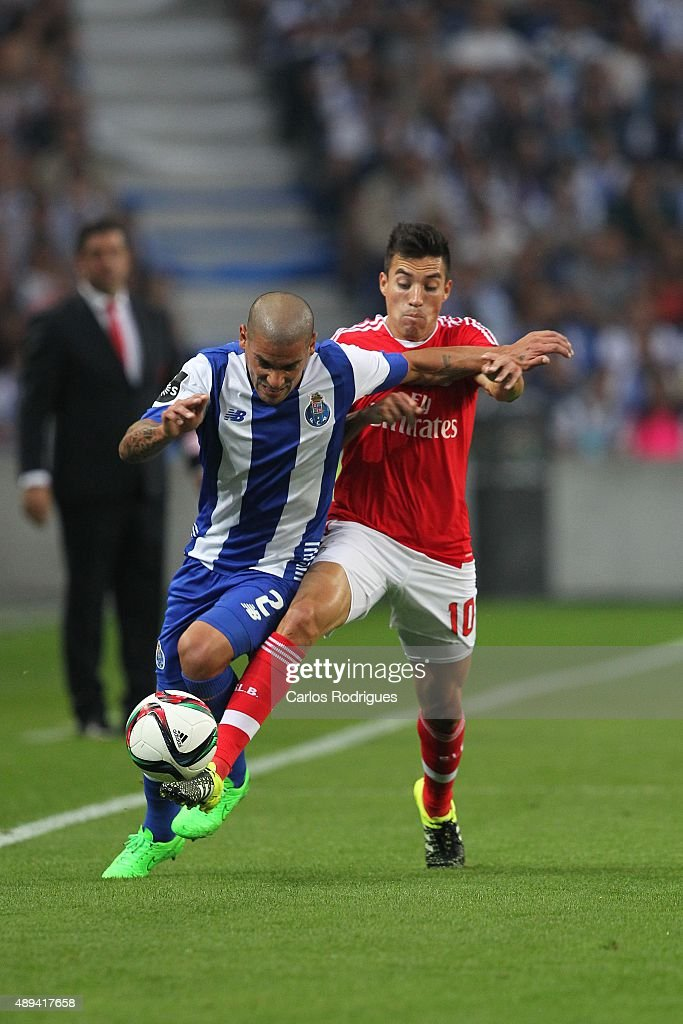 Porto's defender Maxi Pereira vies with Benfica's midfielder Nicolas Gaitan during the match between FC Porto and SL Benfica for the Portuguese Primeira Liga at Estadio do Dragao on September 20, 2015 in Porto, Portugal.