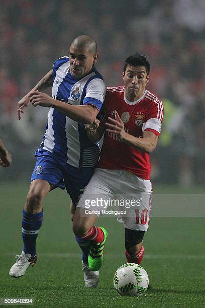 Porto's defender Maxi Pereira vies with Benfica's midfielder Nicolas Gaitan during the match between SL Benfica and FC Porto for the portuguese...