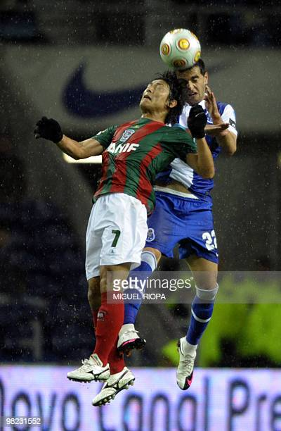 FC Porto´s defender Miguel Lopes jumps for the ball with Maritimo´s japanese midfielder Takahito Soma during their Portuguese first league football...