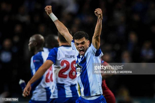 TOPSHOT Porto's defender Pepe celebrates during the UEFA Champions League round of 16 second leg football match between FC Porto and AS Roma at the...