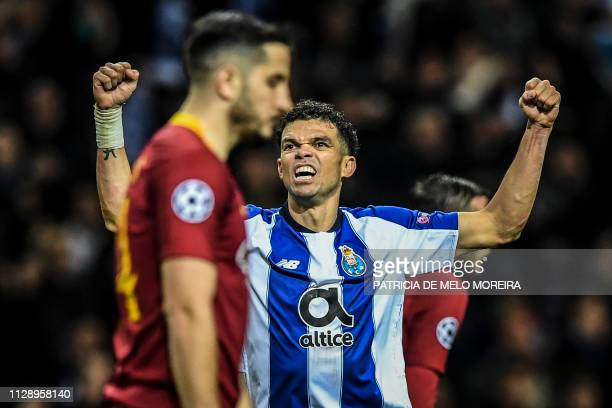 TOPSHOT Porto's defender Pepe celebrates his team's victory at the end of the UEFA Champions League round of 16 second leg football match between FC...