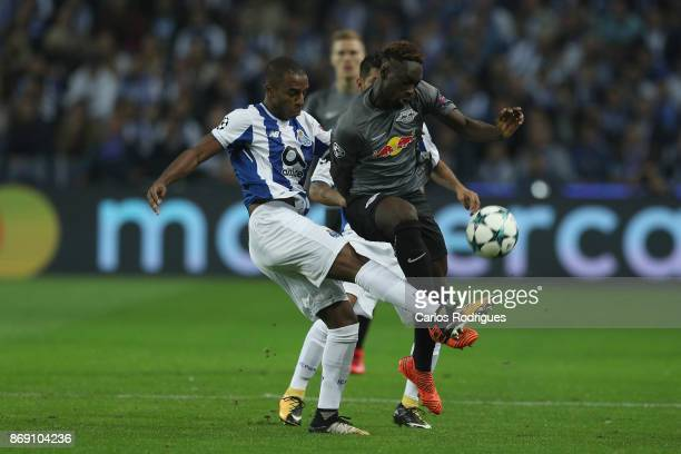 Porto's defender Ricardo Pereira from Portugal vies with Leipzig forward Jean Kevin Augustin from France for the ball possession during the match...