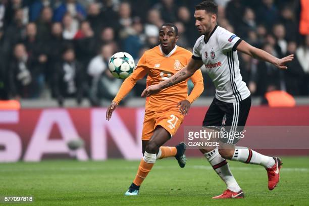 Porto's defender Ricardo Pereira vies for the ball with Besiktas' defender Dusko Tosic during the UEFA Champions League Group G football match...