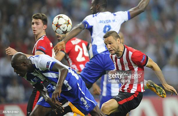 Porto's Dutch defender Bruno Martins Indi and Athletic Bilbao's midfielder Carlos Gurpegui try to head the ball during the UEFA Champions League...