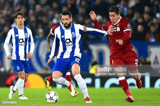 Porto's Felipe competes with Liverpool's Roberto Firmino during the UEFA Champions League Round of 16 Second Leg match between Liverpool and FC Porto...