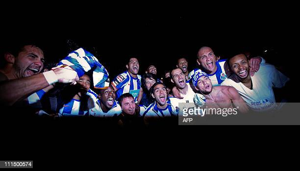 Porto's football players celebrate at the end of their Portuguese League football match at Luz Stadium in Lisbon on April 3 2011 FC Porto's 21...