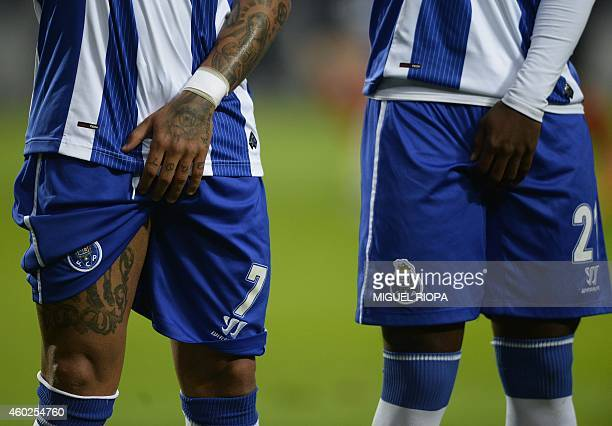 Porto's forward and captain Ricardo Quaresma and Porto's forward Ricardo Pereira protect themselves during a free kick during the UEFA Champions...