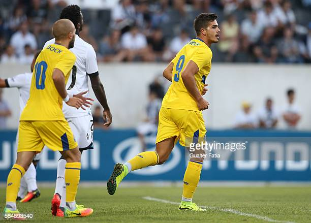 Porto's forward Andre Silva celebrates after scoring a goal during the Guimaraes City Trophy match between Vitoria de Guimaraes and FC Porto at...