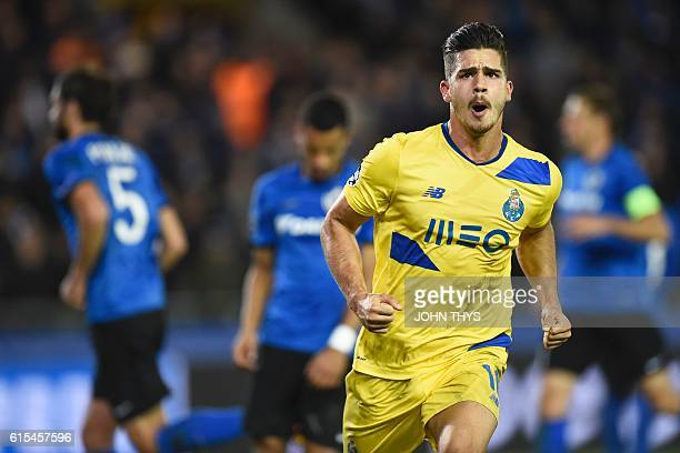 Porto's forward Andre Silva celebrates after scoring a last minute penalty kick during the UEFA Champions League groug G football match Club Brugge...