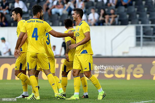 FC Portos forward Andre Silva celebrates with teammates after scoring a goal during the match between Vitoria Guimaraes v Porto match for the...