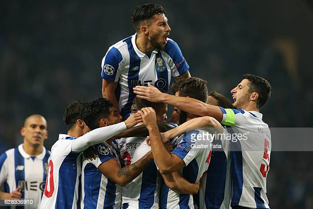 Porto's forward Andre Silva celebrates with teammates after scoring a goal after scoring a goal during the UEFA Champions League match between FC...