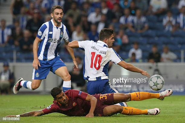 Porto's forward Andre Silva with AS Roma's defender Emerson Palmieri from Brasil in action during the UEFA Champions League match between FC Porto...