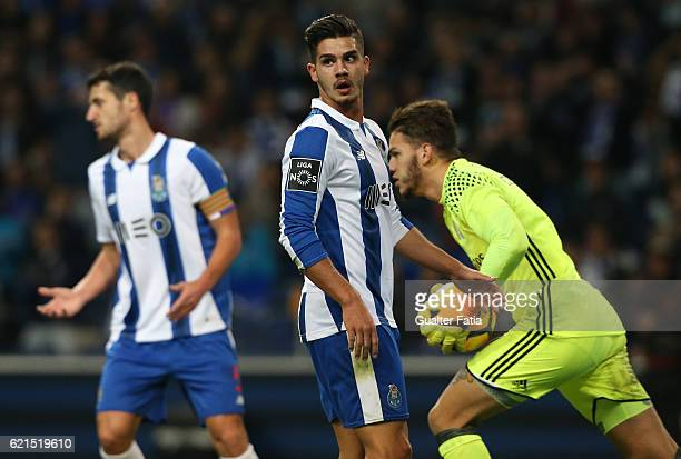 Porto's forward Andre Silva with SL Benfica's goalkeeper from Brazil Ederson in action during the Primeira Liga match between FC Porto and SL Benfica...