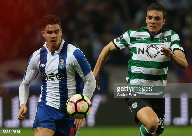 PortoÕs forward Andre Silva with Sporting CPÕs midfielder Joao Palhinha from Portugal in action during the Primeira Liga match between FC Porto and...