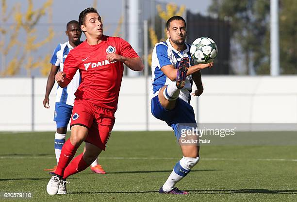 Porto's forward Bruno Costa with Club Brugge KV's forward Jules Vanhaecke in action during the UEFA Youth Champions League match between FC Porto and...