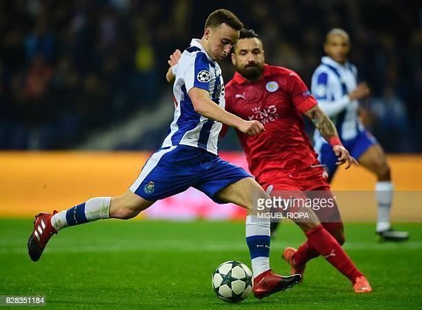 Porto's forward Diogo Jota kicks the ball beside Leicester City's Polish defender Marcin Wasilewski to score his team's fifth goal during the UEFA...