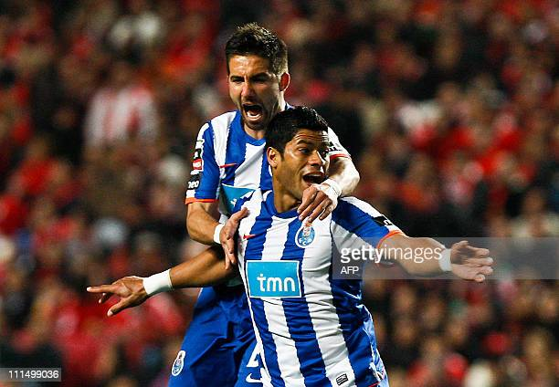 FC Porto's forward from Brazil Givanildo de Souza Hulk celebrates with his teammate midfielder Joao Moutinho after scoring a goal against Benfica...
