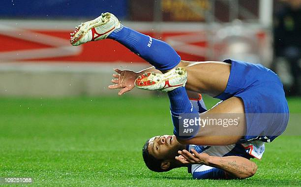 FC Porto's forward from Brazil Givanildo de Souza Hulk falls during the UEFA Europa League football match Sevilla FC vs Porto on February 17 2011 at...