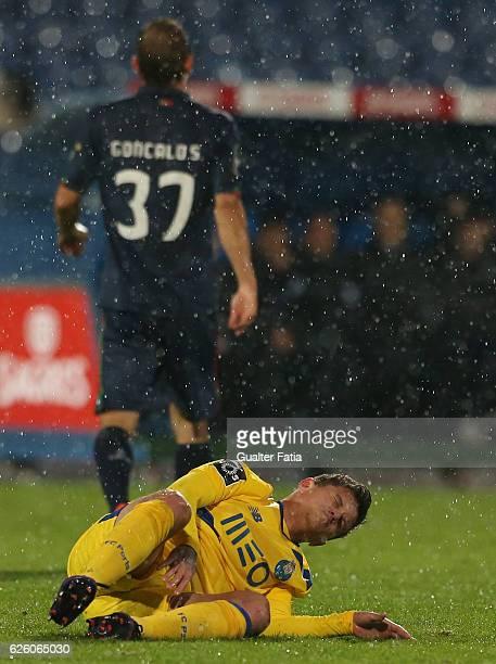 Porto's forward from Brazil Otavio injured during the Primeira Liga match between Os Belenenses and FC Porto at Estadio do Restelo on November 26...