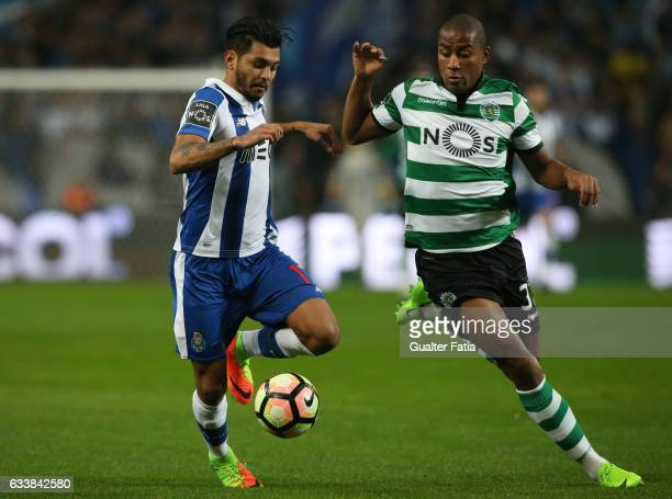 PortoÕs forward from Mexico Jesus Corona and Sporting CPÕs defender Marvin Zeegelaar from Holland in action during the Primeira Liga match between FC...