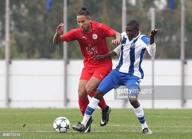Porto's forward James Artur with Faiq Bolkiah of Leicester City FC in action during the UEFA Youth Champions League match between FC Porto and...