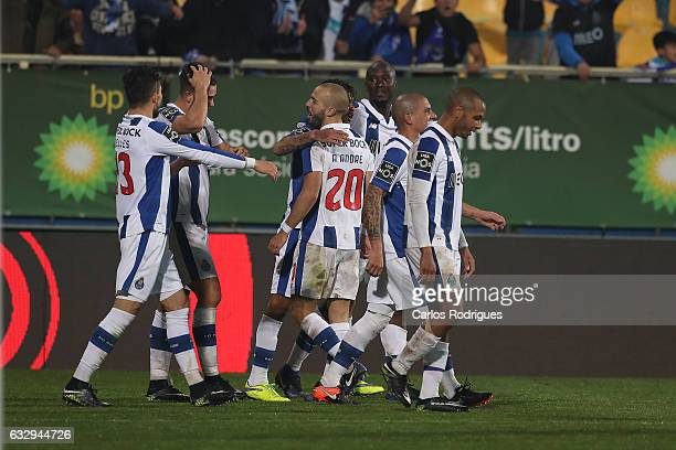 Porto's forward Jesus Corona from Mexico celebrates scoring Porto second goal with his team mates during the match between Estoril Praia SAD and FC...