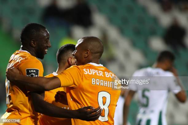 Porto's forward Moussa Marega celebrates with Porto's midfielder Yacine Brahimi after scoring during the Portuguese League football match between...