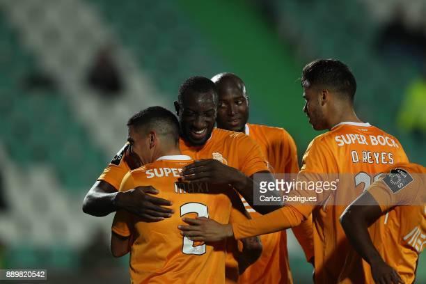 Porto's forward Moussa Marega from Mali celebrates scoring Porto second goal with his team mates during the match between Vitoria de Setubal FC and...
